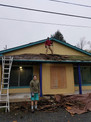 John and Ethen demolishing the porch