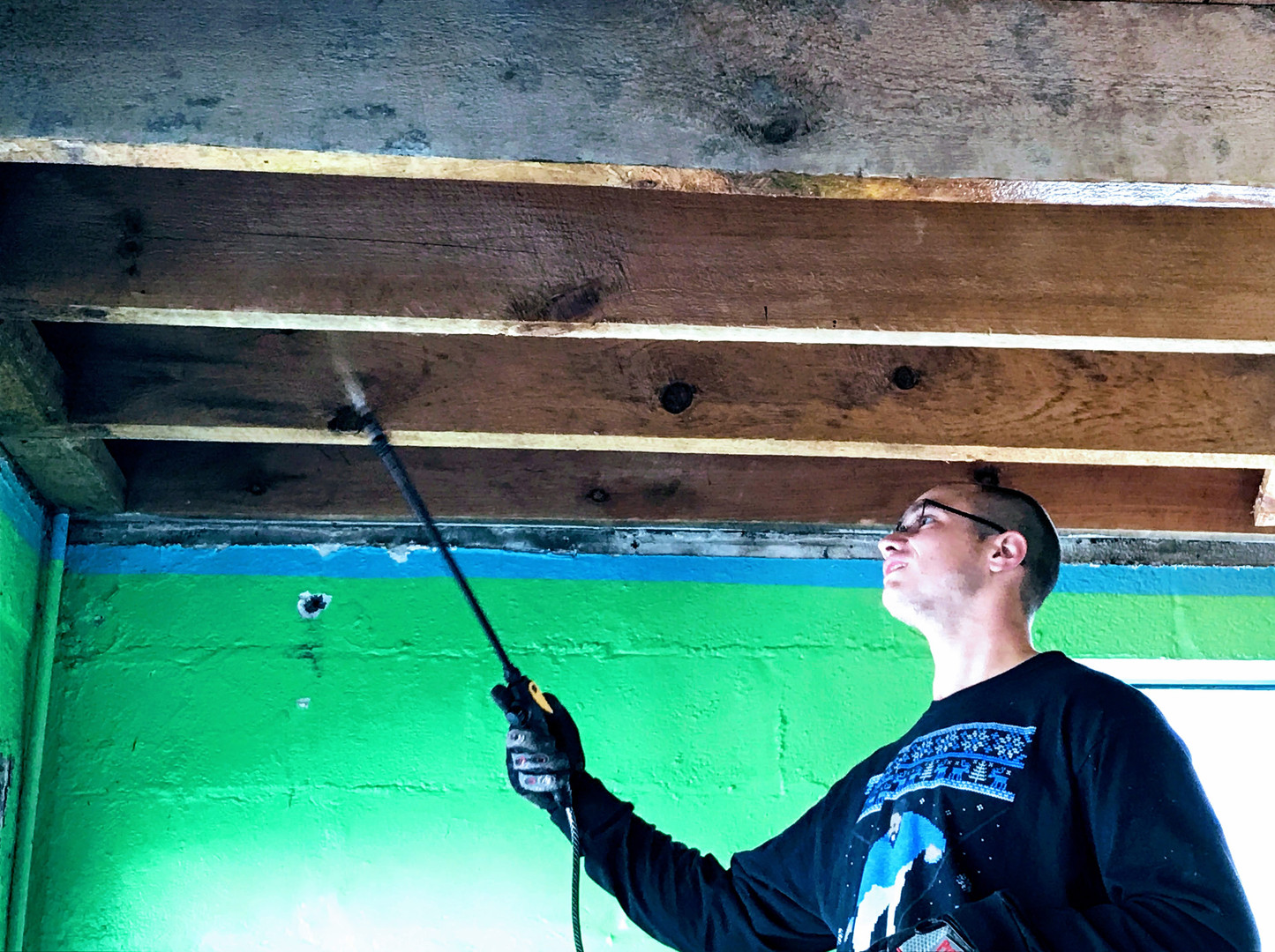Ethan sealing the ceiling