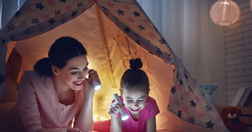 mum and girl in tent.png