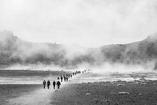 People walking across remove valley