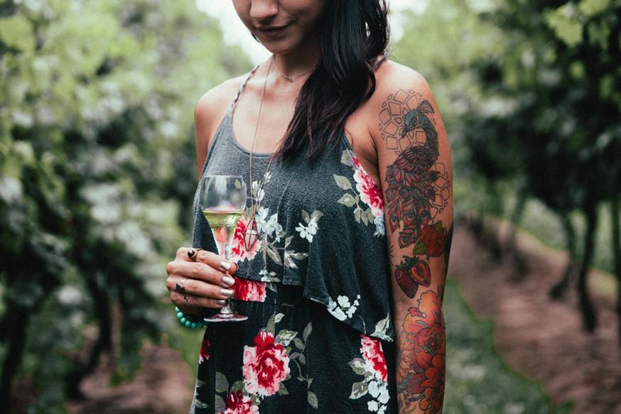 womens-fashion-tattoo-holding-glass-of-w