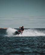man-takes-sharp-turn-on-jet-ski_edited.j