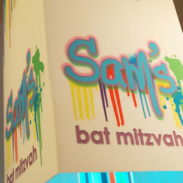 sam's 'paint drips' bat mitzvah party décor