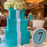 ava's 'fave color' bat mitzvah centerpiece and table numbers