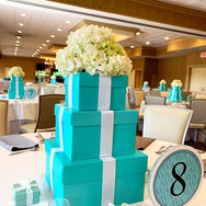 ava's 'fave color' bat mitzvah centerpieces and table numbers