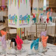 sam's 'paint drips' bat mitzvah party décor