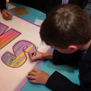 sam's 'paint drips' bat mitzvah signing board