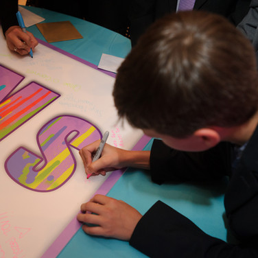 sam's 'paint drips' bat mitzvah signing board