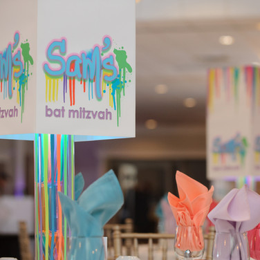 sam's 'paint drips' bat mitzvah centerpiecess
