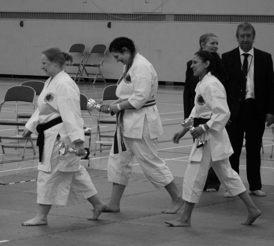 Womens Team Kumite collecting gold