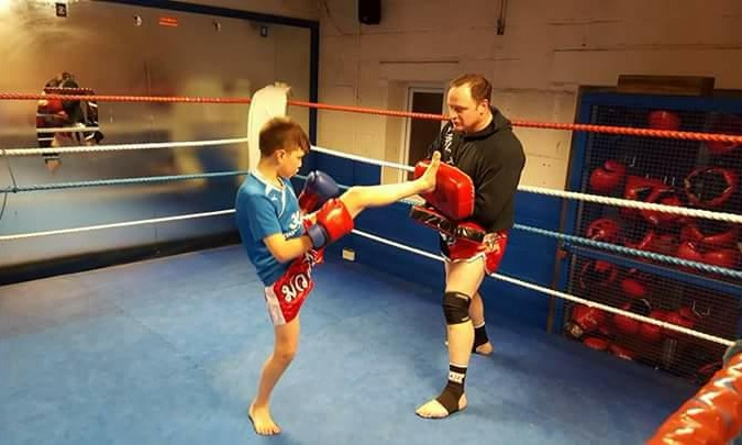 Neil training a young student