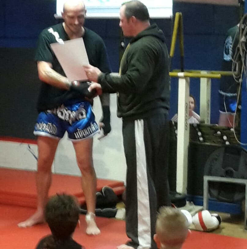Neil awarding Mark certificate