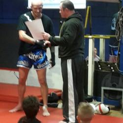Neil awarding Mark certificate