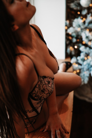 boob shot during christmas boudoir photography