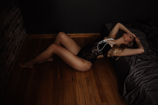 wood floors and black lingerie with pearls for a timeless boudoir photo