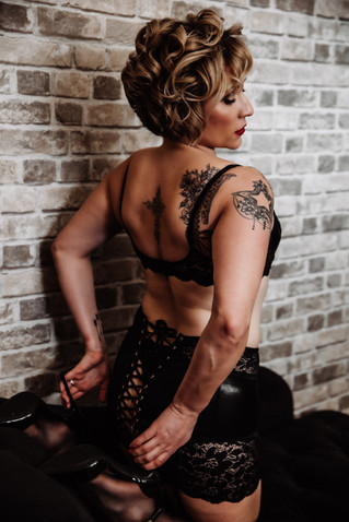 tattoos and short hair with black leather lingerie and heals