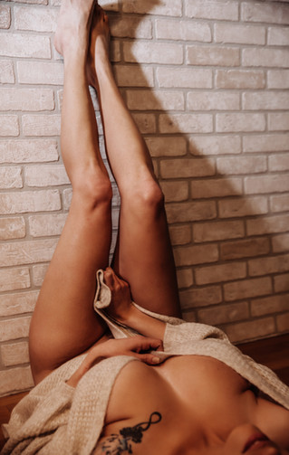 legs up with nothign but a sweater and a brick wall