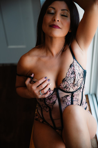 boob grab in victorias secret lingerie in the window light