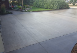 Coloured driveway with broom finish
