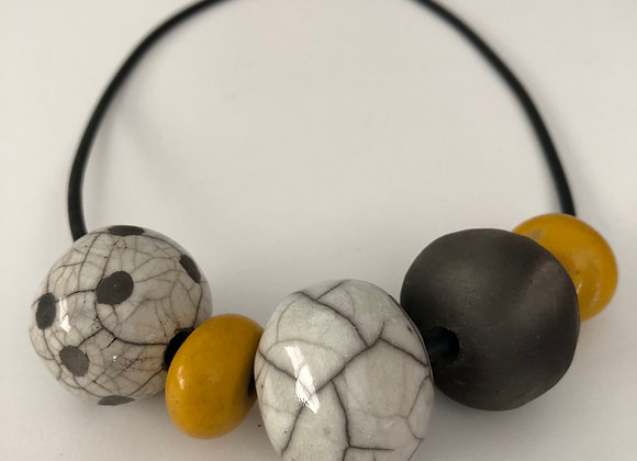 Raku fired ceramic beads (3) with yellow resin