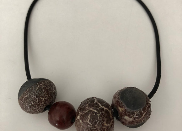 Black clay beads with crawl glaze and serpentine