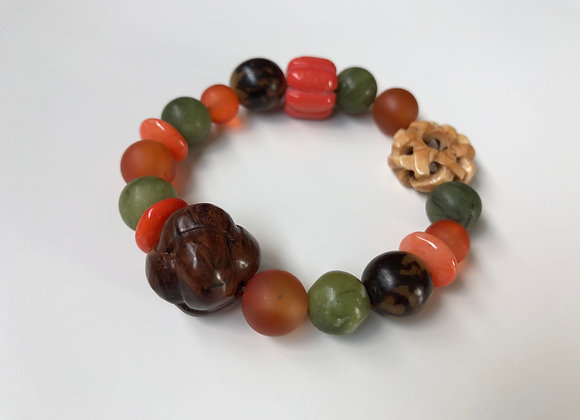 Orange coral, natural jade, and wood
