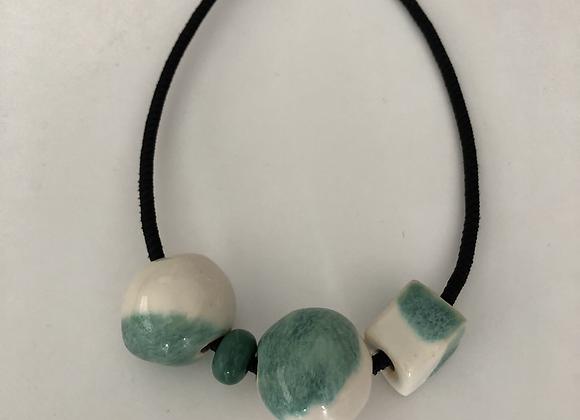 Green and white glazed ceramic beads