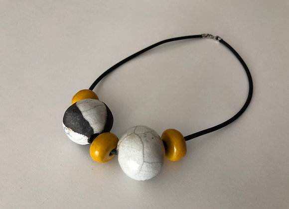 Raku fired ceramic beads with yellow resin