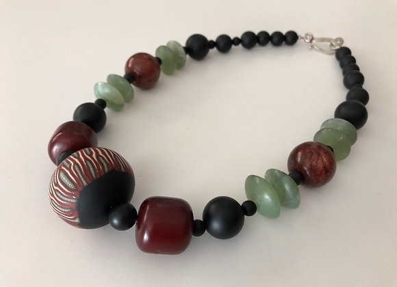 Green aventurine, fimo clay, and onyx
