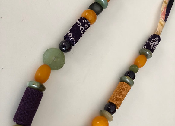 Purple/gold long necklace with Japanese fabric cord and mixed beads