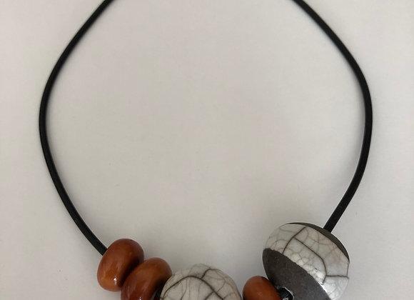 Raku fired ceramic beads with orange resin
