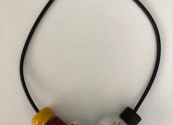 Raku fired ceramic beads with red, yellow, and black resin