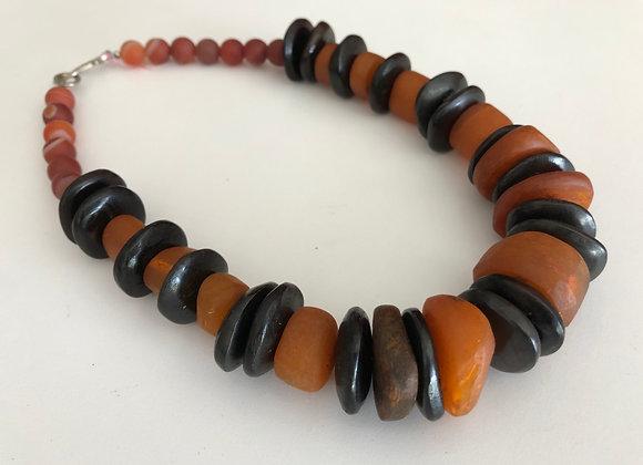 African orange and black bone