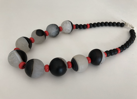 Agate and quartz composite, red coral, and matte black onyx