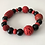 Thumbnail: Red cinnabar, black onyx, and red coral