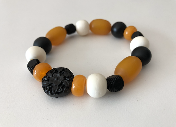 Black cinnabar, yellow resin, and white bone