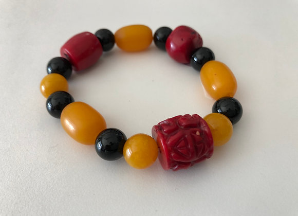 Red coral, yellow jade and black onyx