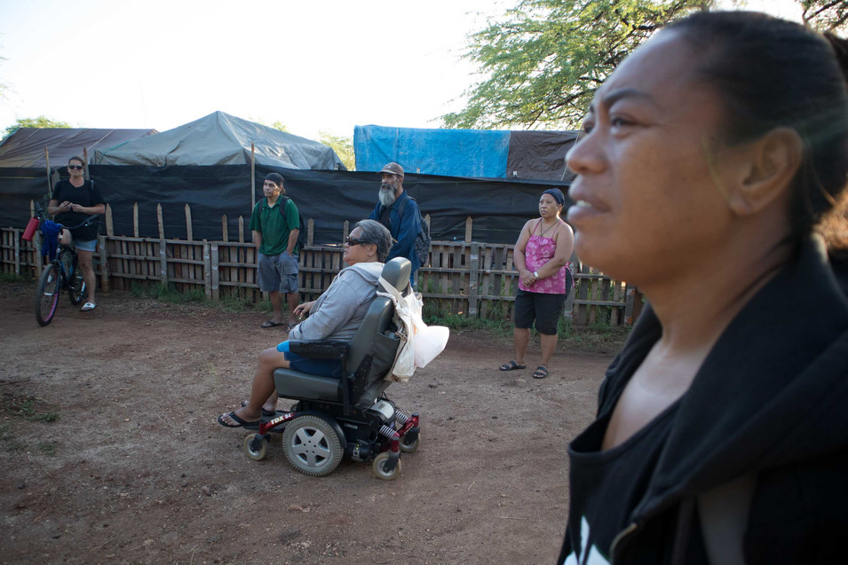 Pu'uhonua is strict in mainting the existing rules and regulation. It is mendatory for the residents to attend the community meetings where the captains reflects any updates or concerns. Keala listens to the last community meeting of 2019. She holds the last home in the shelter closest to the primary school.
