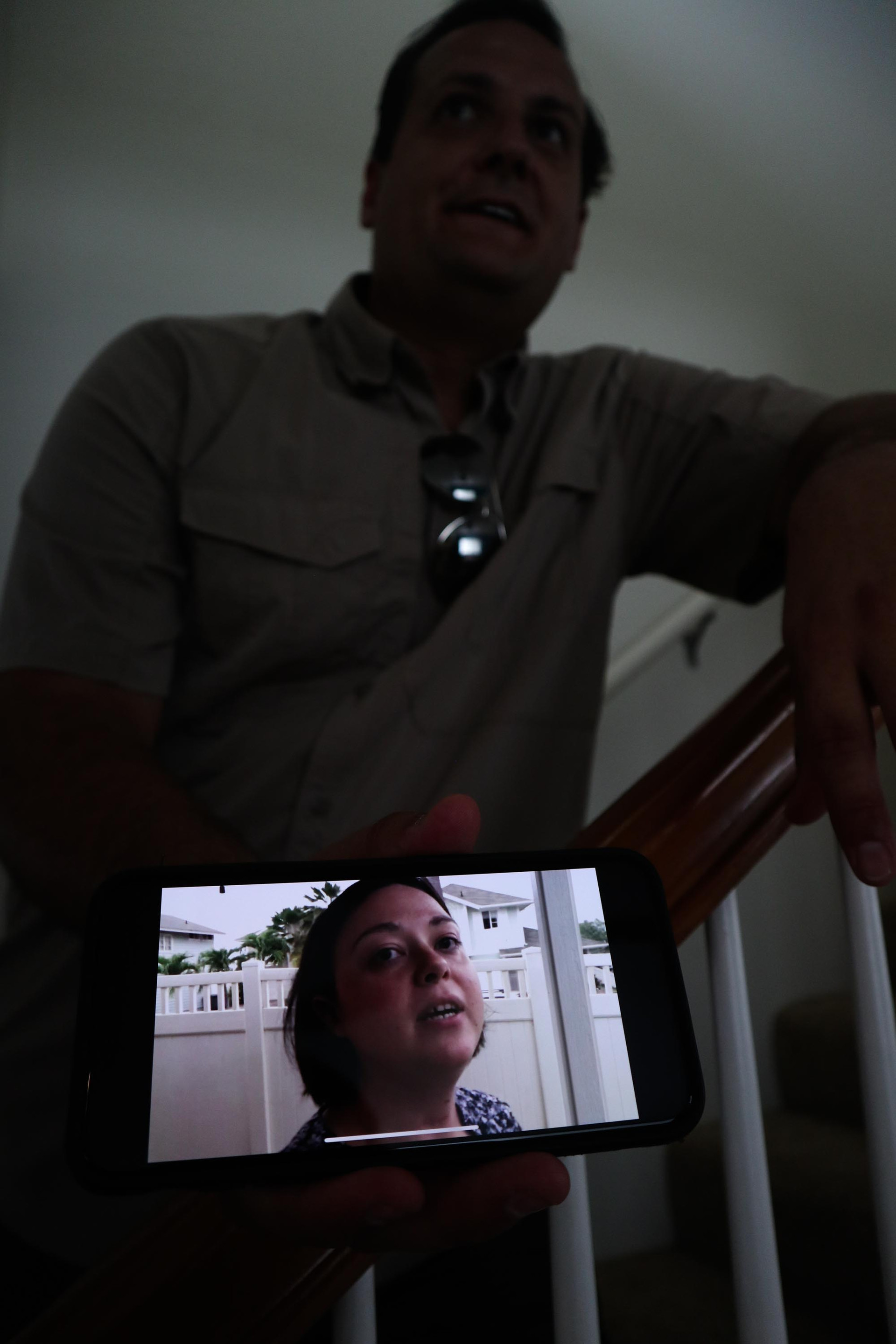 Stremel shows a picture of his ex-wife on the staircase in his home. A phone picture shows Strammel's ex-wife April carrying their son Calvin.