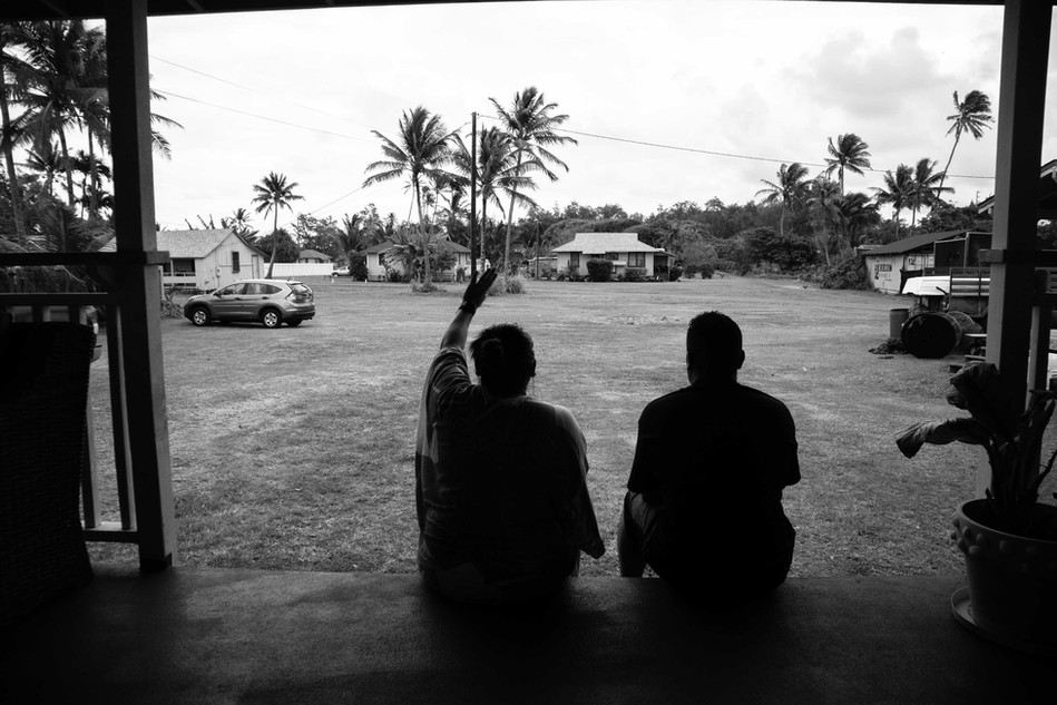 """Kahuku village hosts around seventy homes. Back in the days in order to live here (Kahuku Village) it was required to have to be a family or relative of a plantation worker. Melissa husband (Mikey) is the grandson of a plantation worker which ended up giving him a place in the village. Deep inside the village there are places which are around hundred years old. It represents the roots of the natives living in the Hawaiian Islands. According to Melissa the turbine contractor doesn't care about what people like her thinks. """"Now AES is coming to my home and saying sorry you can't live here anymore"""" she said."""