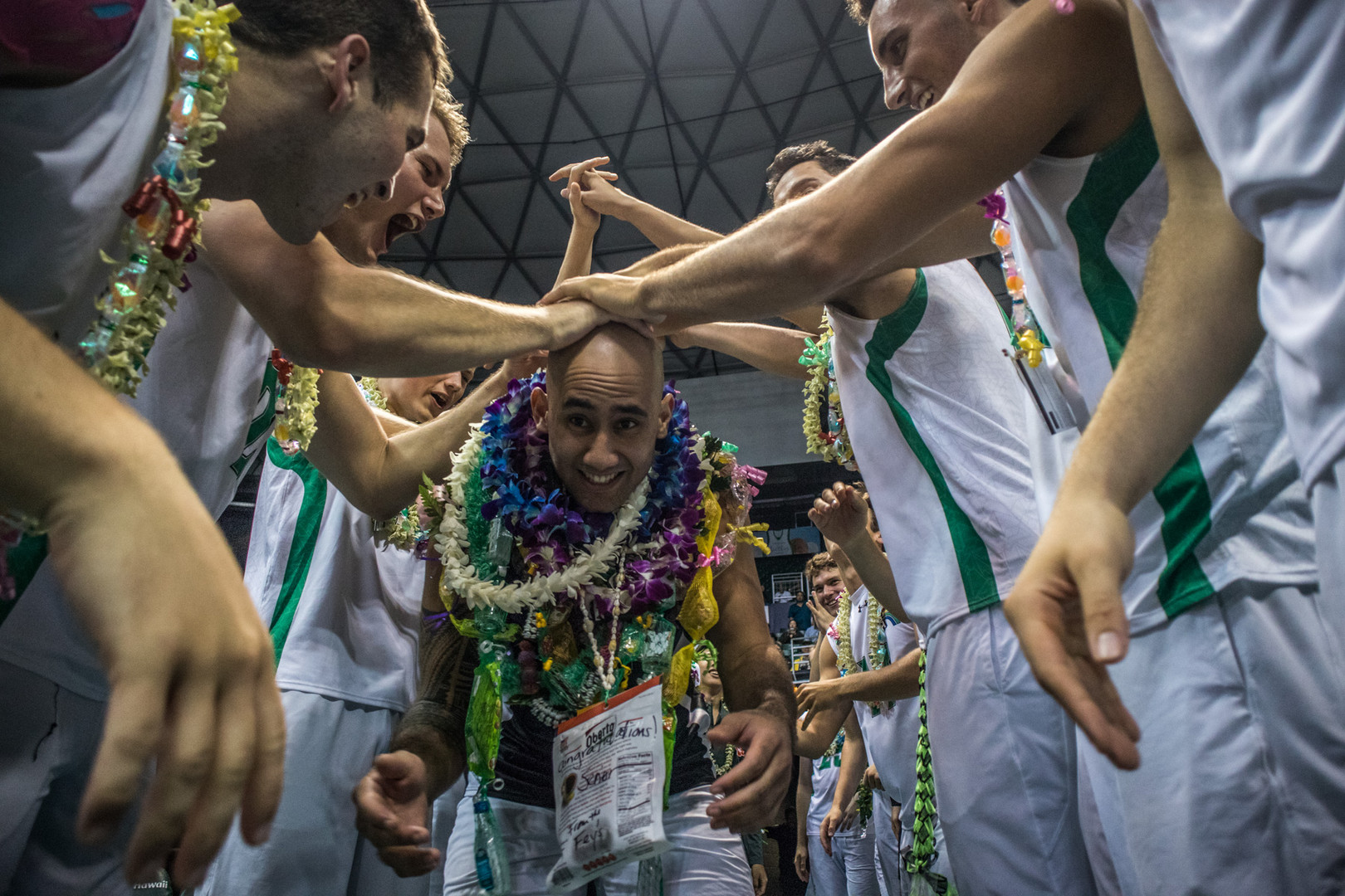 Hawaii's Larry Tuileta makes his appearence through the guard of honor tunnel during men's volleyball senior night on April 15, 2018.