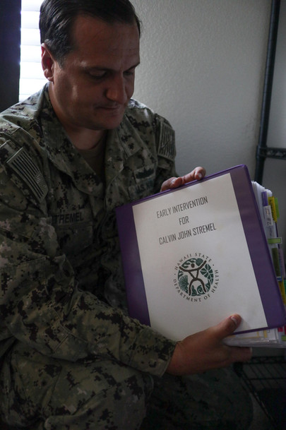 Jon Stremel holds his case documents at his home in Wai'anae, Hawai'i.