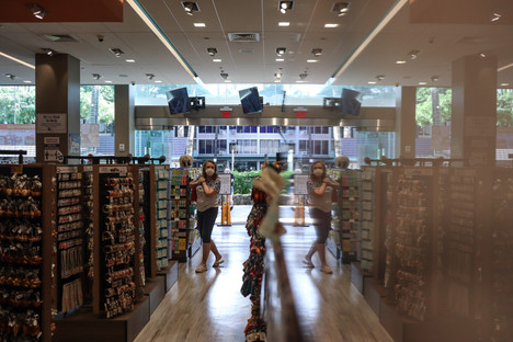 A customer takes a stroll the ABC Store in International Market Place at Waikiki on November 20, 2020. According store owner Paul Kosasa, the coronavirus pandemic has cut down about 70 percent of customer engagement in his stores.