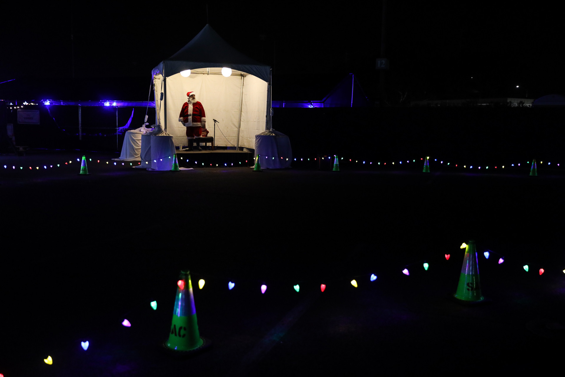 Gonzales looks out for the last car on December 21, 2020 from the tent which was given to him after he faced hard times in the rain during the Christmas light show.