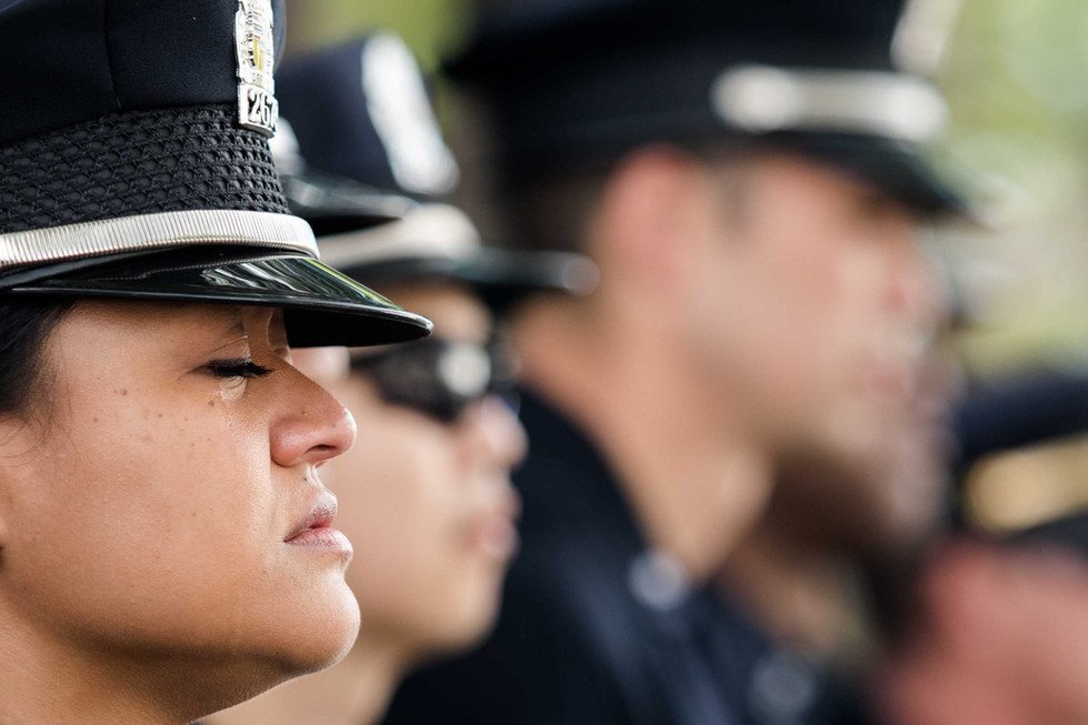 Honolulu Police Department officer F. Solomon mourns during the final salute for fallen Honolulu Police Department officer Tiffany-Victoria B. Enriquez on Thursday, January 30, 2020. On Jan. 19, 2020 officer Enriquez along with one other officer were fatally shot, and seven Diamond Head homes were destroyed after a man who was being evicted, allegedly stabbed a Hibiscus Drive homeowner in Honolulu.