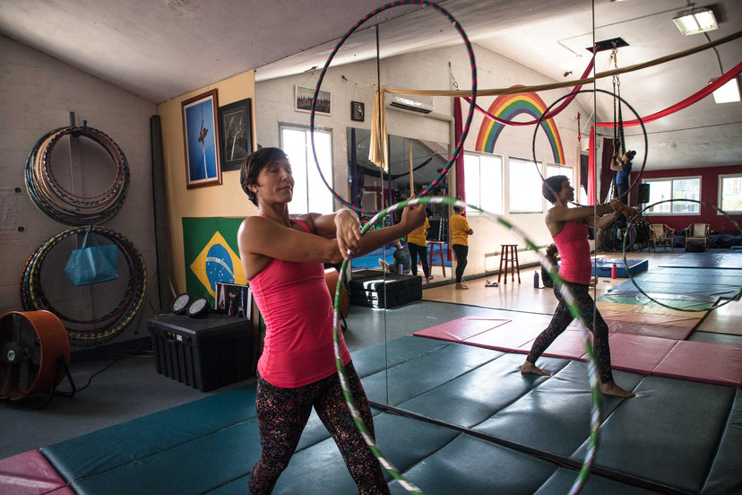 Colleen McCown, a social work master's student at the University of Hawai'i at Mānoa, shows her expertise as a circus artist by performing as a fire and aerial dancer. She is also a counselor at the Juvenile Justice Center providing help to youth and families, working in special education at Waikiki Elementary School, and a yoga and fitness instructor. Fifteen years ago, after finishing her bachelor's in Psychology at the University of Missouri, she moved to Hawai'i.