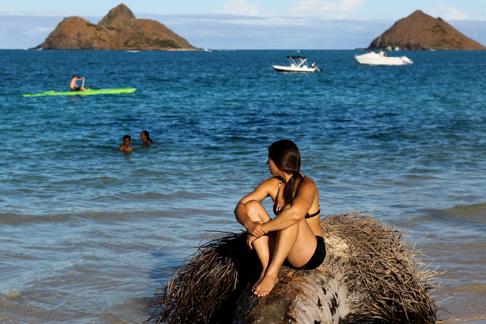 Rower Lia Ditton sits looks out to the ocean sitting in a stagnant coconut tree timber on October 1, 2020 in Lanikai Beach, Kailua, HI.