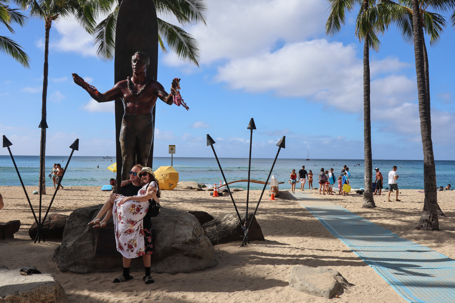 Tourists enjoy their time infront of Duke statue at Kuhio Beach in Waikiki on November 2020. From October 15, 2020 Hawaii has opened its gate to the incoming tourists through pre-travel testing program that allow travelers to come to the Hawaiian islands without 14-day quarantining.
