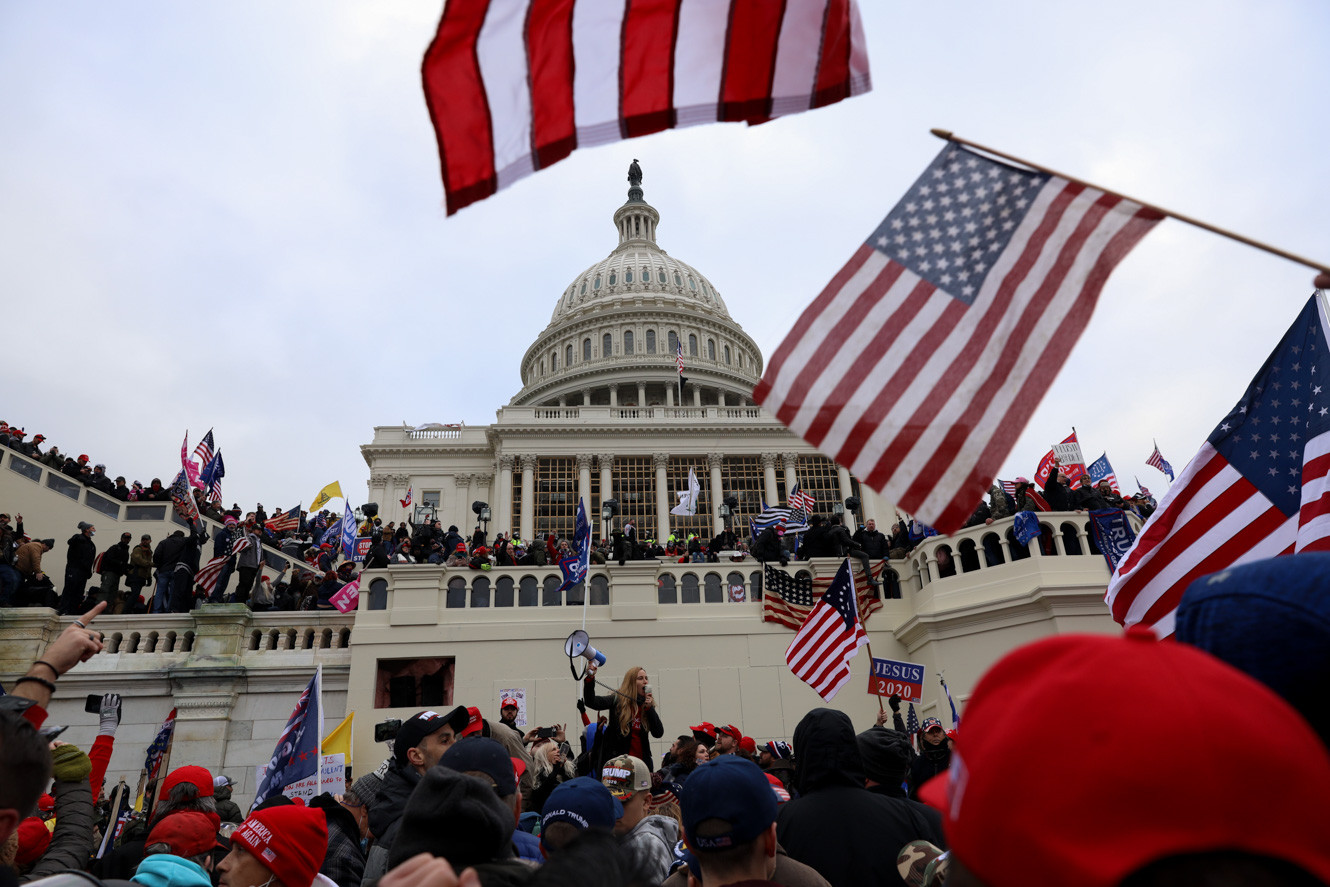 Pro-Trump supporters storm to the US Capitol on January 6, 2021 in oppose to President elect Joe Biden's victory and election fraud. Previously Trump supporters broke through the police barricades to enter the main entrance (Shafkat Anowar/AP Photo).