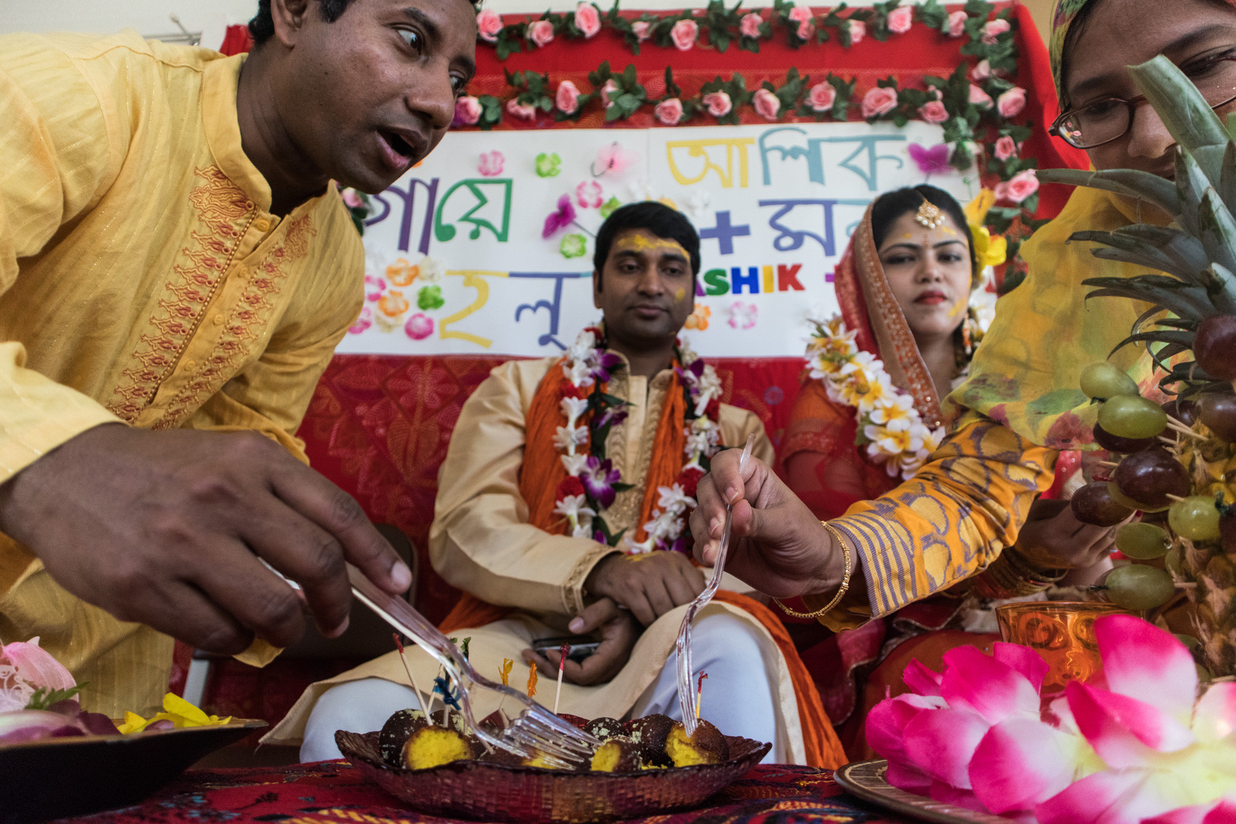 Attending guests feed the bride and groom with types of Bangladeshi sweets. It is a tradition where along with putting turmeric on bride and groom's face, the guests offers them sweets as a portrayal of a peaceful start to their marital life.